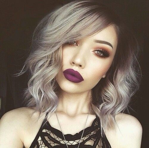 Grey balayage short hair matched with smokey eye and plum full lipstick