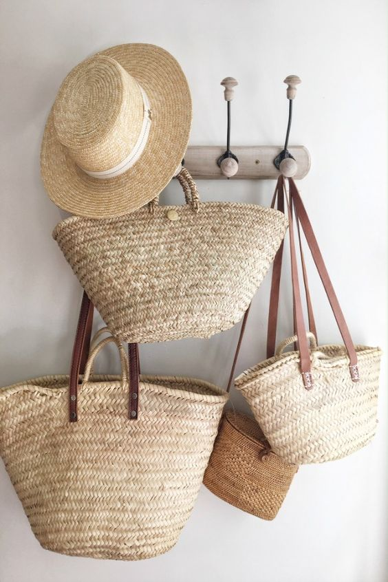 Charming French market baskets from Vivi et Margot hang from a hook in a French farmhouse. #vivietmargot #frenchmakret #frenchbaskets #marketbaskets #summerliving #rusticdecor #frenchcountry