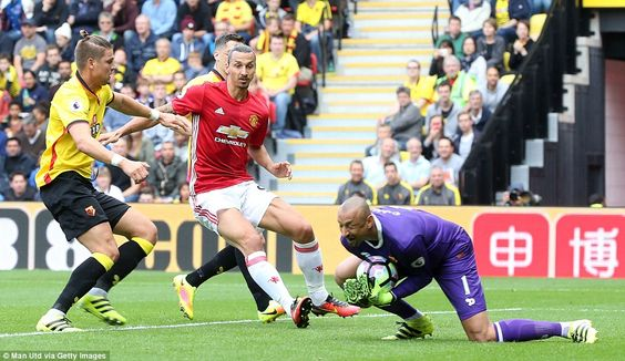Watford goalkeeper Heurelho Gomes collects a low right-wing cross ahead of…