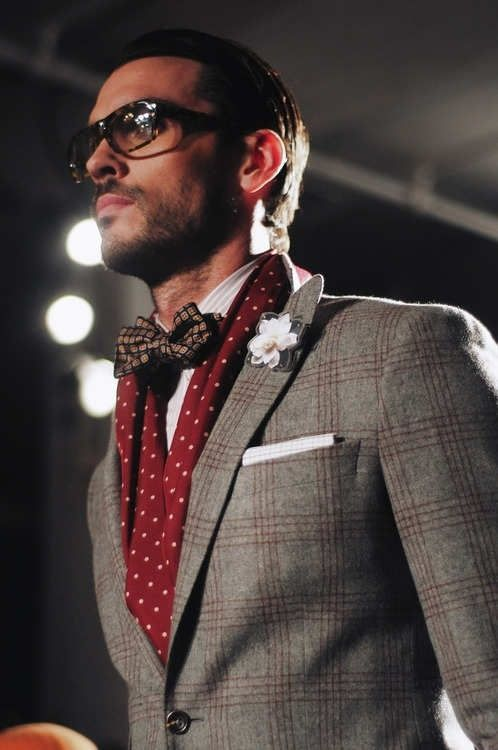 Shop this look on Lookastic:  http://lookastic.com/men/looks/blazer-scarf-pocket-square-lapel-pin-bow-tie-dress-shirt/8996  — Grey Plaid Wool Blazer  — Red and White Polka Dot Silk Scarf  — White Pocket Square  — White Floral Lapel Pin  — Brown Print Bow-tie  — White Vertical Striped Dress Shirt: