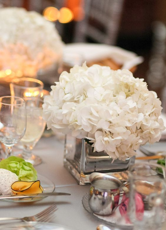Chic white floral wedding reception centerpiece; Featured Photographer: Kelly Brown Weddings