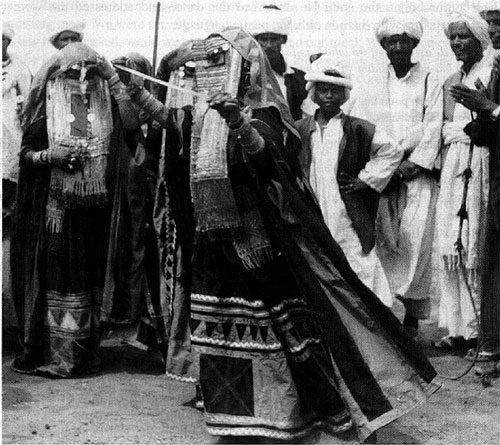 Rashaida woman dancing, Saudi Arabia c.1920 | by Tribes of the World: