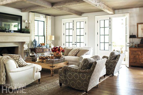Jane Green's comfortable Westport family room with reclaimed lumber beams & french doors to garden