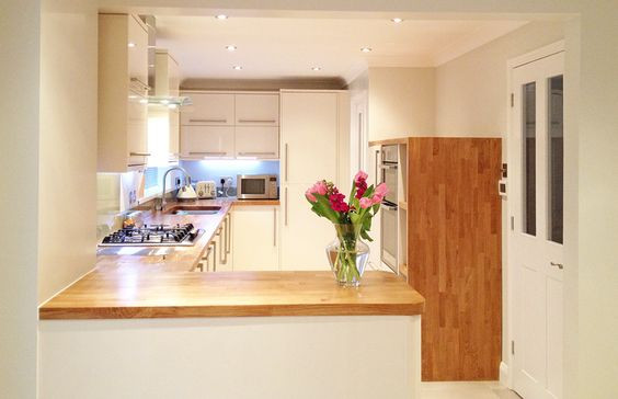 modern kitchen norwich with cream units and oak worktops