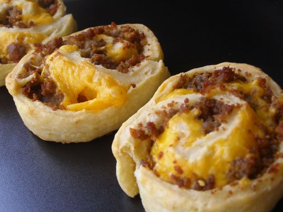 sausage pinwheels.super easy...crescent roll sheet spread evenly with cream cheese, sausage and cheddar cheese.  roll up and bake in oven for about 15 minutes or until golden brown.