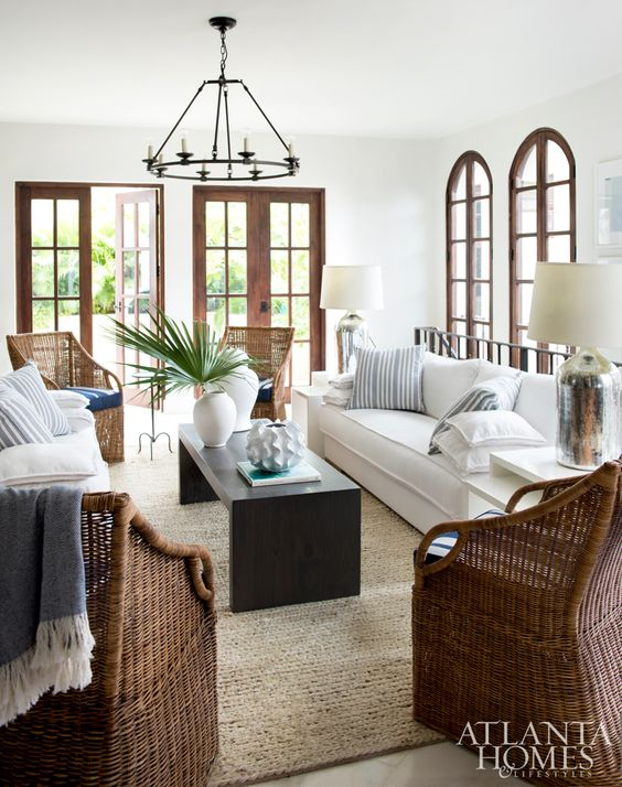 Sofas from Bungalow Classic and armchairs from Williams-Sonoma Home provide ample seating in the narrow formal living room. Chandelier and lamps, Restoration Hardware.