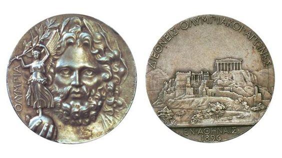 Medalla olímpica de los primeros Juegos Olímpicos Modernos.No hubo medallas de oro,los ganadores recibían medallas de plata y el segundo lugar medalla de cobre,no había premio para el tercer lugar.