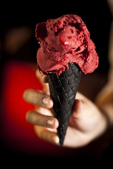 Dark chocolate waffle cone with deep red raspberry and strawberry topping, yummy!