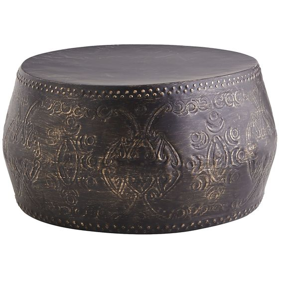 Handcrafted from powder-coated wrought iron in a rich, dark finish, this coffee table adds exotic intrigue to your patio or living area. Not to spoil the air of enigma, but it doubles as extra seating. The only mystery is how you'll choose to use it.