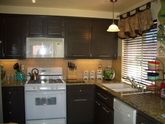 Honey oak kitchen updated to dark chocolate brown i kept for Brown kitchen cabinets with black appliances