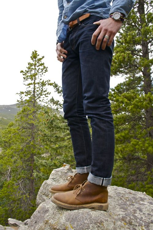 Men's street fashion styles; outdoors sports wear for the weekend hike, denim shirts, sports watch and great contrasting leather accessories, with slim fit jeans