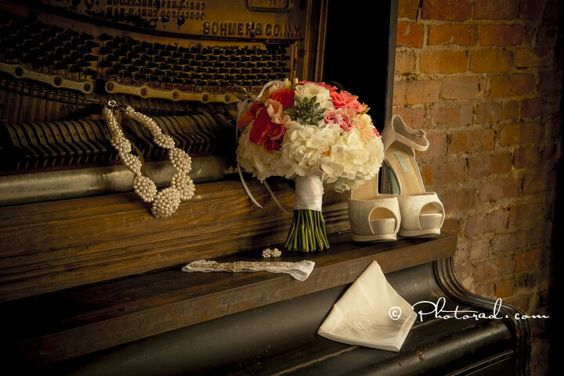 This white hydrangea, succulent and pops of coral bouquet (Beautiful Flowers by June) adorns the historic piano at the Brooklyn Arts Center so beautifully...