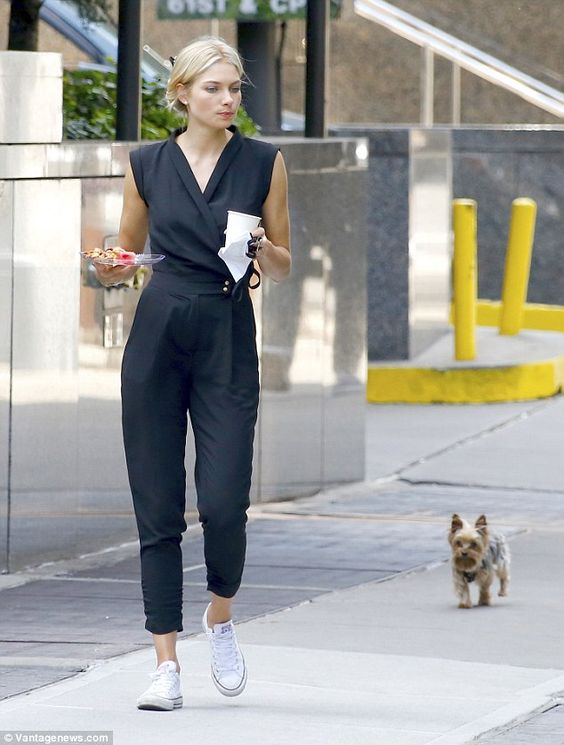 Casual but chic: Jessica Hart takes her tiny pooch, Floyd, for a walk while juggling a pla...