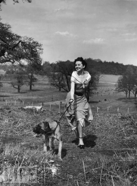 Audrey running with a dog.