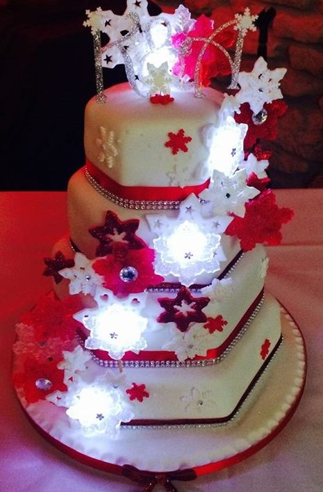 Snowflake themed winter wedding cake with edible glass snowflakes and lights by Corr's Cakes