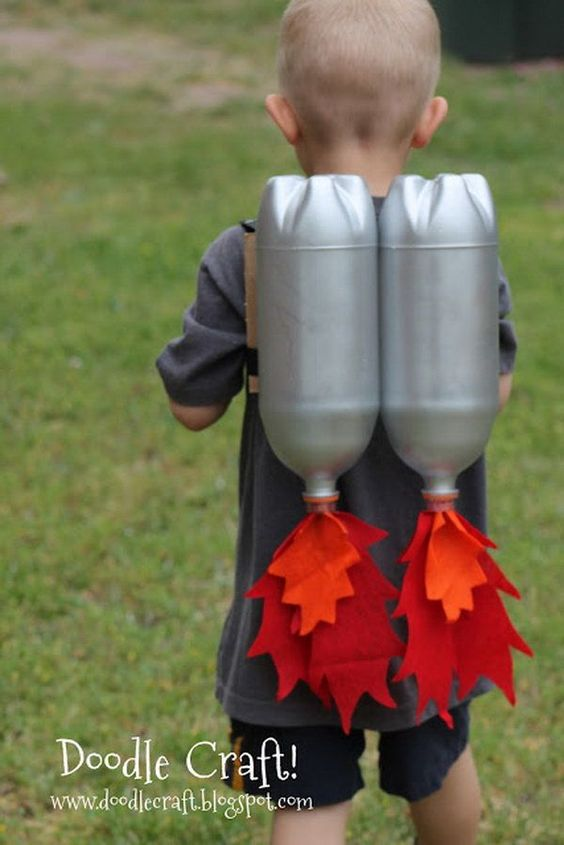 DIY Jet Pack with Soda Bottles. Make a jet pack out of spray-painted bottles and red and orange fabric. Great for outerspace play! Tutorial via: