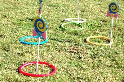 Then, we did a lollipop ring toss. I used my Cricut Expression to make these lollipops for the game. The rings were on major sale because they are just plastic pool toys from the summer! Here are some pictures of the game- I think the kids had fun with it!