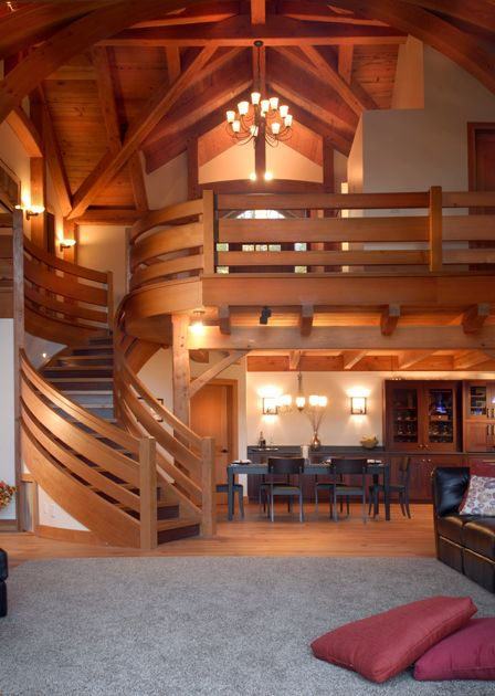 http://timberframe-postandbeamhomes.com/galleries/timber-frame-homes/timber-frame-home-interiors