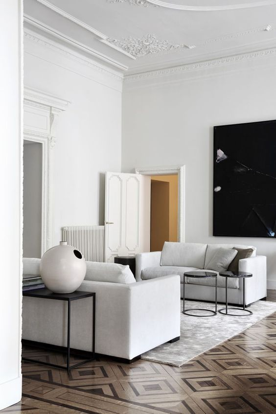 Elegant White Living Room With Ornate Floors And Crown Mouldings Simple Boxy White Sofas Copy T Home Interior Design Minimalist Living Room Interior Design