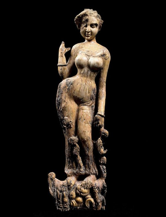Afghanistan. Hellenic cultural and artistic influences can be seen in many pieces at Tillya Tepe found alongside artefacts from China and India.  Statuette of a woman standing on a makara, possibly a furniture ornament from the 1st-2nd centuries AD made from ivory