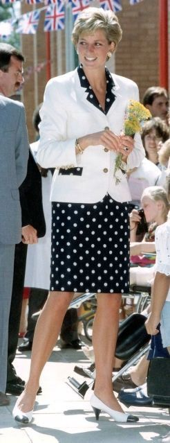 July 24, 1990: Princess Diana talks to Paul Brien who has been fitted with a body brace at the Royal National Orthopaedic Hospital in Stanmore in the London borough of Harrow.