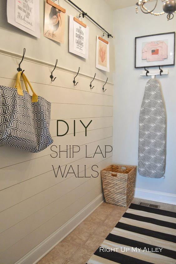 Laundry room: hooks, ship lap, hanging ironing board