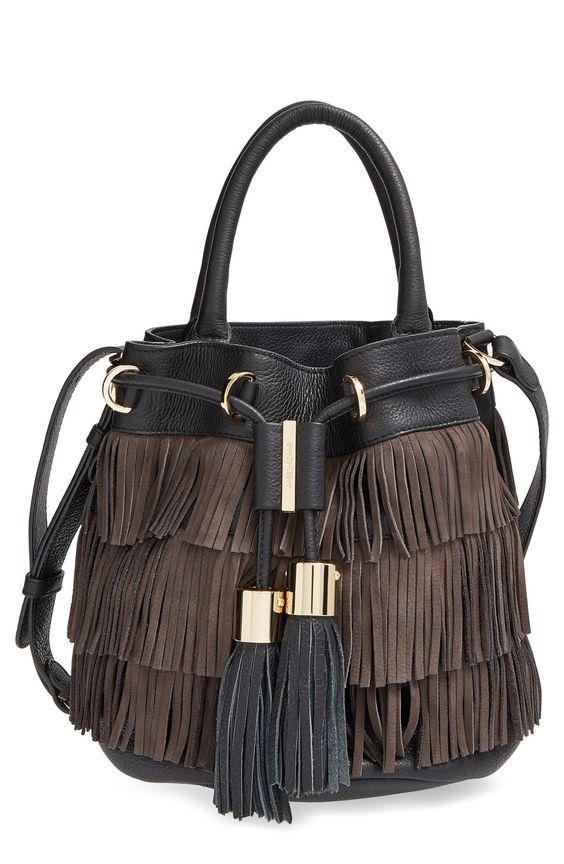 Polished gold hardware calls attention to the dramatic tassels of this fringe-covered drawstring bag shaped from lavishly textured leather for a playful, street-savvy look.