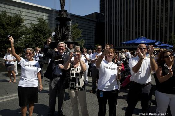 American Modern Insurance employees cheer as the company name is announced.