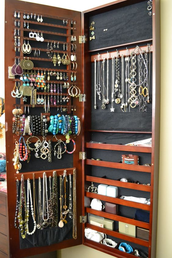 Lori Greiner Jewelry wall mounted Organizer. 169.00 on QVC. Now this is cool!!