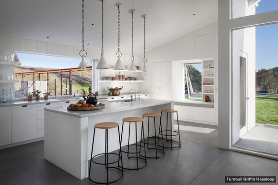 Antiques and Modern Pieces Mix in The Coolest London Home // marble kitchen island, bar stools, white pendant lights, large windows: Griffin Haesloop, White Kitchen, Sonoma County, Farmhouse Kitchens, Pendant Lights, County Residence, Kitchen Ideas, Kitchen Islands