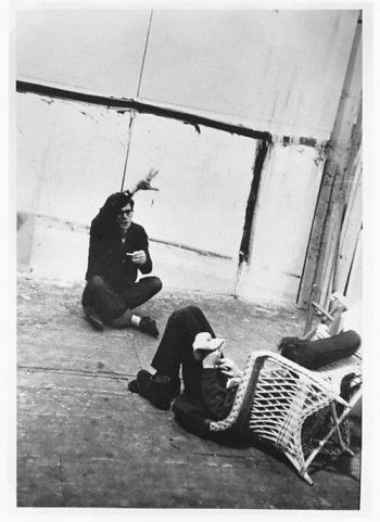 Allen Ginsberg & Gregory Corso seated on the floor in conversation, during the filming of Pull My Daisy, New York City, 1959