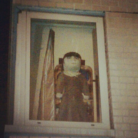 CREEPER doll staring out the window at night on York avenue nyc