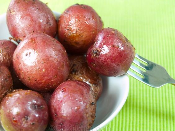 A 5-star recipe for Broasted New Potatoes made in the crock pot made with red potatoes, olive oil, Italian dressing