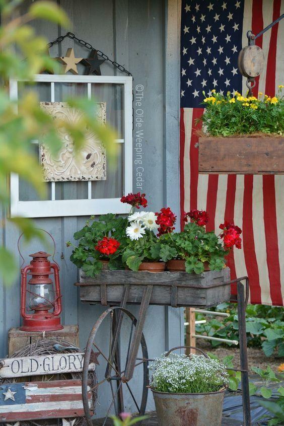 12 Spectacular Farmhouse Style Patriotic Porches One Thousand Oaks Front Porch Decorating Porch Decorating Farmhouse Style Decorating