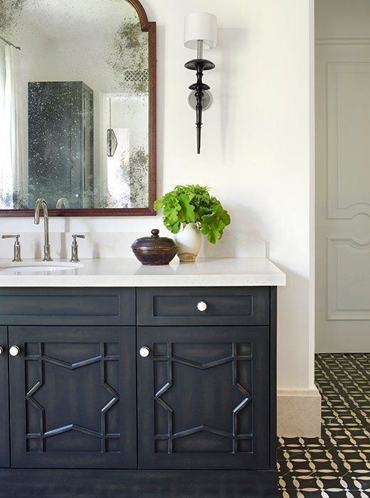 Beautiful black vanity in a bathroom designed by Betsy Burnham. Come check out Antique Vintage Style Bathroom Vanity Inspiration! #bathroomdesign #bathroomvanity #classicstyle #traditionaldecor #interiordesignideas