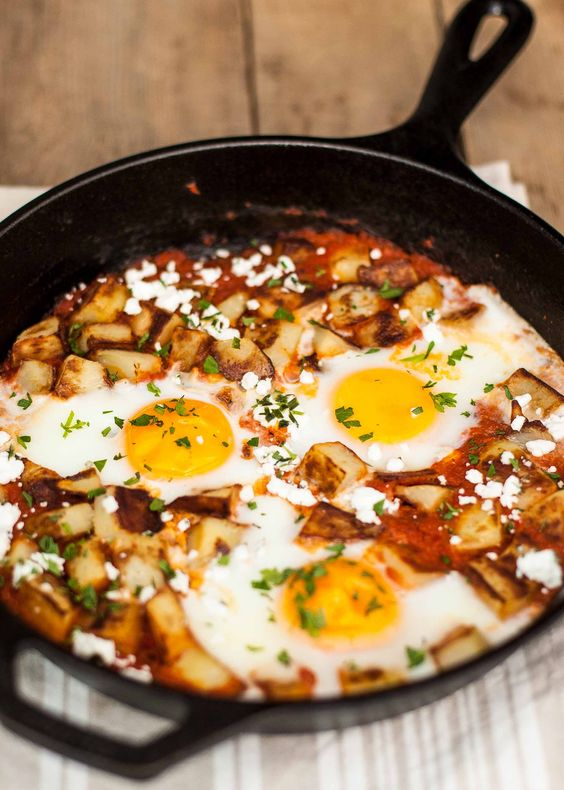 Why not serve eggs for dinner?! Fried potatoes and eggs baked in spicy ...