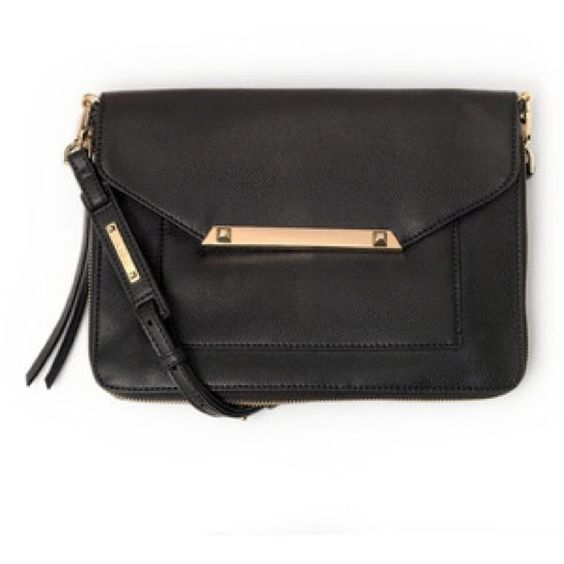 Stella & Dot black Tia cross body purse bag zipper Only sued as a sample! An adorable, trendy and versatile cross body. A true best seller! Available in red as well in another listing! Stella & Dot Bags Crossbody Bags: