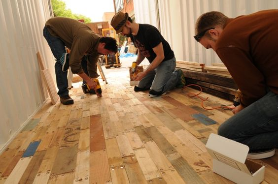 This is reused pallet wood as flooring for a shipping container project. I love it.