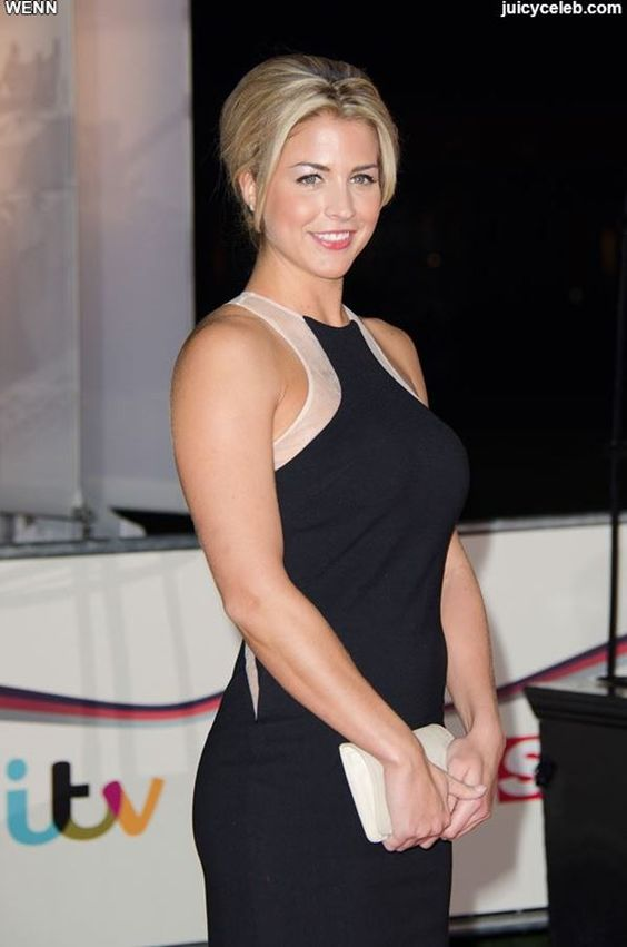 Gemma Atkinson showed that push up corsets never go out of style when she wore a shiny blue number at Debenham's in Glasgow and flaunted her 32DD's in all their glory.