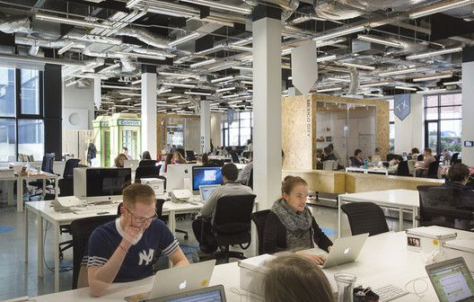 Airbnb's European Operations Hub in Dublin, Ireland. A dynamic and flexible work environment – including a meeting room, modeled after an Amsterdam apartment, which can be split into two separate spaces.
