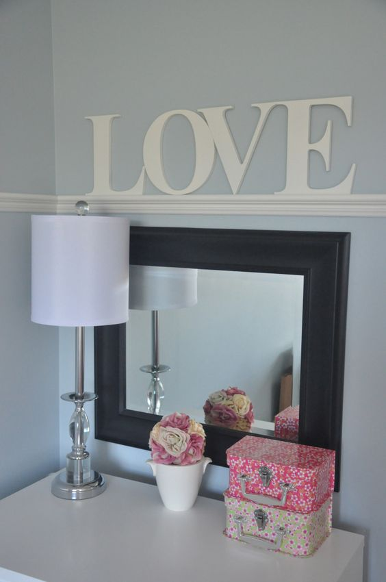 "This ""Love"" sign from @Homeworks Etc Kids works perfect for a nursery and can grow with the child's room to later hang over a desk or vanity!"