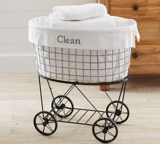 Rolling Wire Hamper & Liner | Pottery Barn  (this thing is ridiculously expensive, but I do have an antique bassinet...hmmmmm. For extra bedding storage.)
