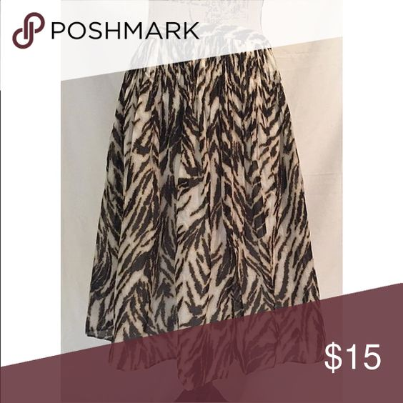 """Talbots Animal Print Skirt Talbots. Size 6. Brown and cream patterned skirt. Fully lined. Zips up the side. W: 14"""", H: Free, L: 25"""" Talbots Skirts A-Line or Full"""