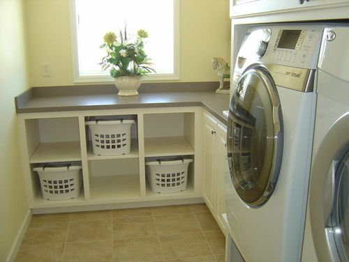 Counter for folding with space for everyone's basket of clean clothes below. Love this!