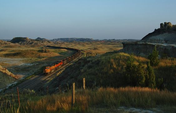 """https://flic.kr/p/yeKZGL   Ballast in the Badlands - Sully Springs, ND   Ticking down my last ten minutes of sun, empty ballest hoppers roll through the iconic Sully Springs on a beautiful September afternoon. It took me a couple of hours to find the """"Steep Butte"""" as I have heard it called by others. Atop this rock cut, an outstanding view of the badlands can be had. Certainly worth the long trek to get here."""
