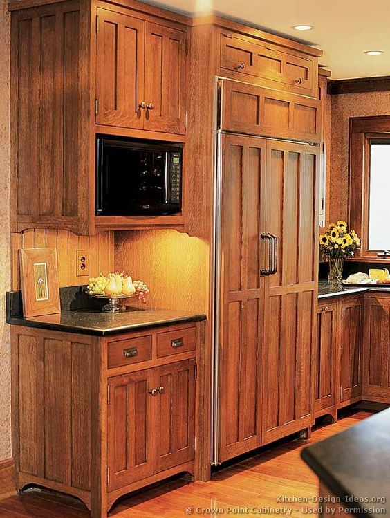 Traditional medium wood brown kitchen cabinets 03 for Brown wood kitchen cabinets
