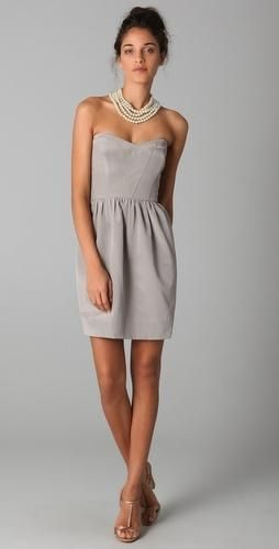 This grey cocktail dress hugs the model&-39-s figure. A pairing body ...