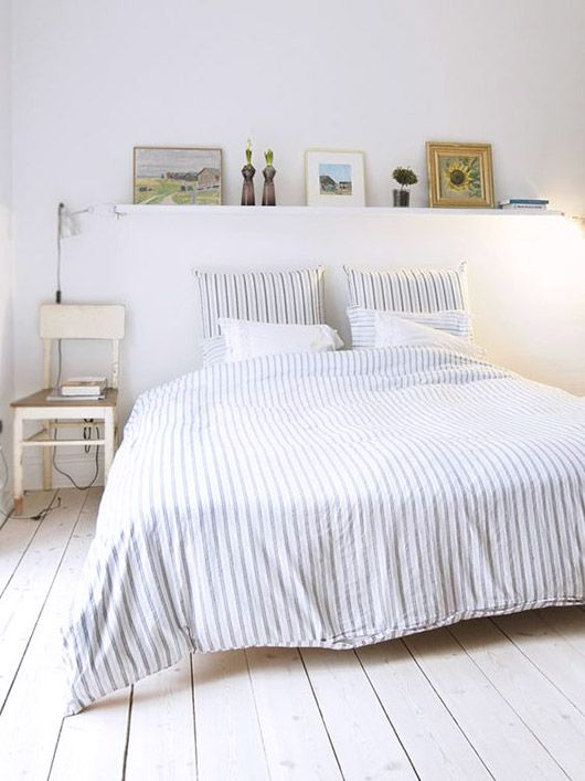 striped bedding with white chair side table / sfgirlbybay