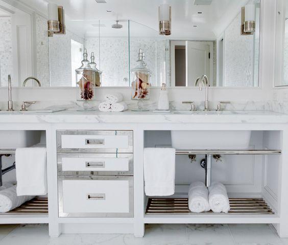 Spa like bathroom with custom vanity and built in mirror with inset sconces. Spa like bathroom with custom vanity and built in mirror with