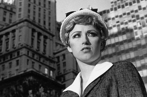 Cindy Sherman - Untitled Film Still #21, 1978. Courtesy Metro Pictures, New York.She creates staged photos where she dresses as other characters questioning her own identity
